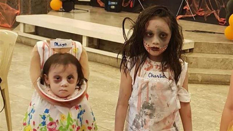 Девочка пришла на Хэллоуин в костюме с головой в руках