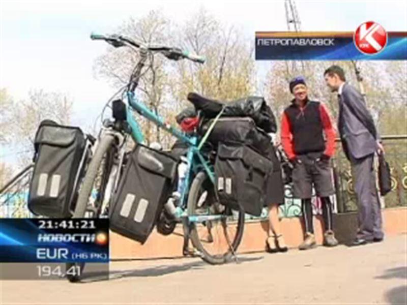 Житель Китая решил попасть на Олимпийские игры на велосипеде