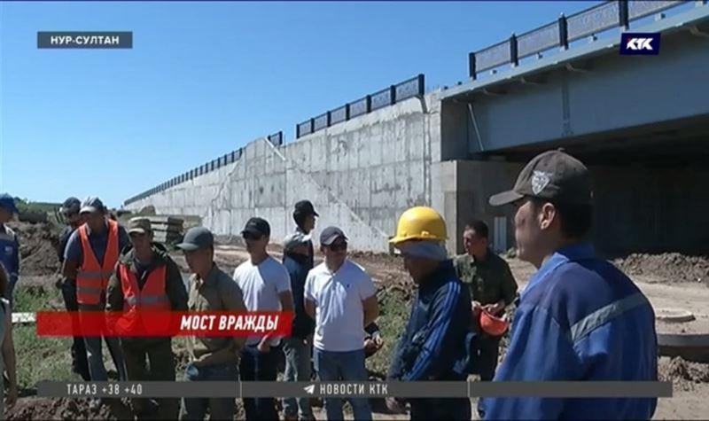 В Нур-Султане рабочие отказываются продолжать строительство моста: им не платят за работу