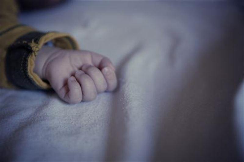 Похороненный заживо младенец найден в Китае