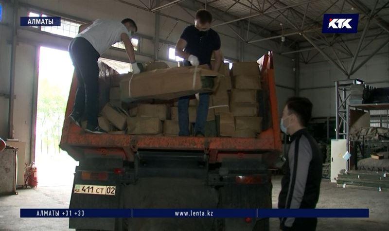 Новости - Добровольцы участвуют в подготовке двух спорткомплексов Алматы под стационары