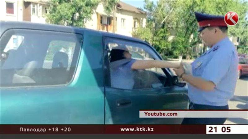 За маты и рукоприкладство в отношении полиции женщине-водителю грозит арест