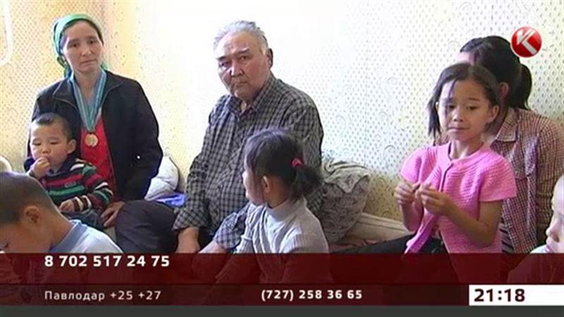 В Астане многодетной семье оралманов нашли временное жилье