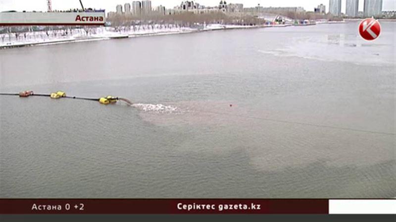 Астанада Есіл өзеніне белгісіз сұйықтық құйылып жатыр