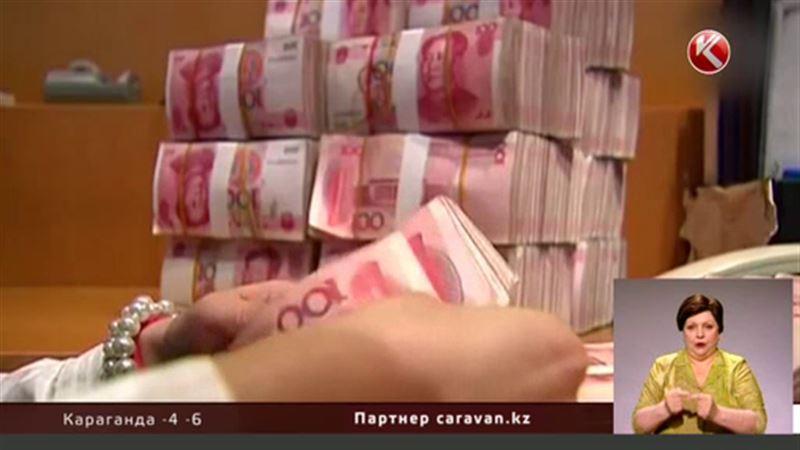 Курс юаня к доллару достиг четырехлетнего минимума