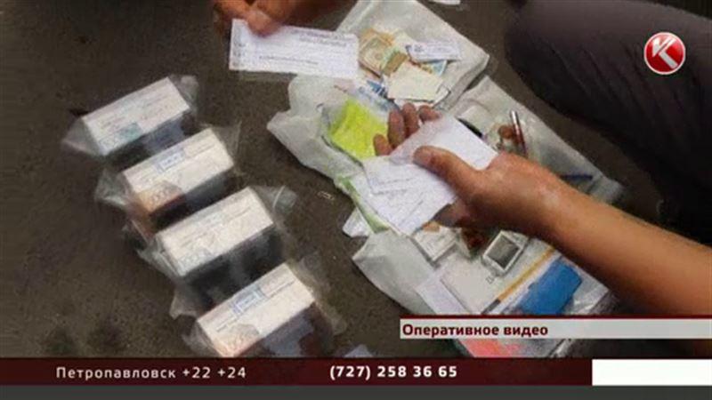 В Алматинской области задержали финансовых аферистов