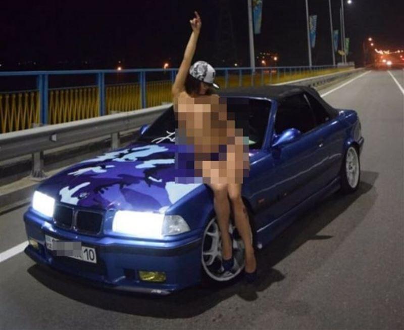 В Костанае водитель заплатит штраф за фото голой девушки на капоте BMW