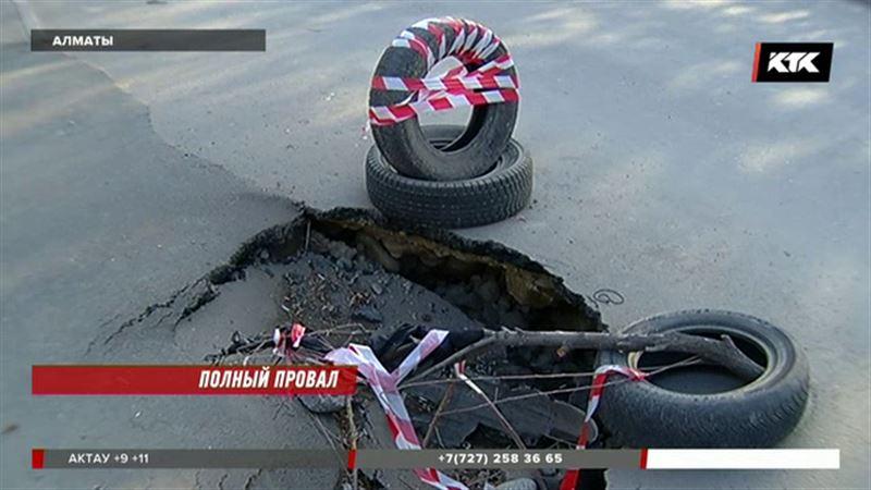 В Алматы на новом асфальте уже проваливаются машины