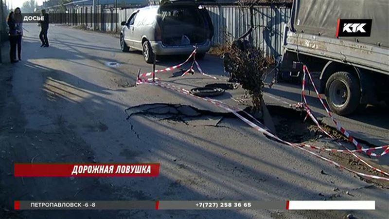 В уничтожении нового асфальта на дорогах Алматы виновны старые трубы