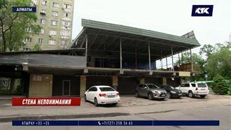 Жильцы алматинской многоэтажки разоблачают планы хозяина скандальной автомойки